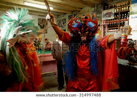 PILLARO, ECUADOR - JANUARY 4, 2014: Diablada, popular town celebrations with people dressed as devils dancing in the streets - stock photo