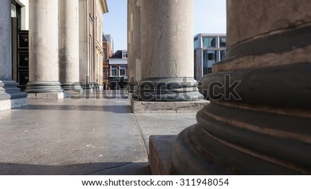 Pillars of court house in Leeuwarden close up in morning sunlight - stock photo