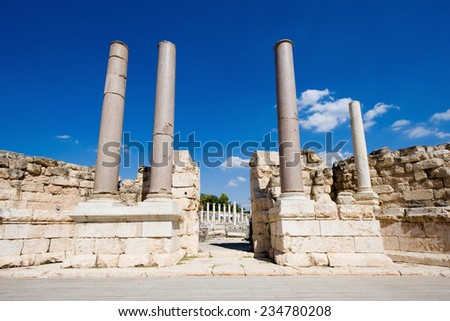 Pillars on the stage of the amphitheater of Beit She'An in Galilee in Israel. - stock photo