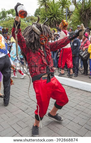 Pilllaro, ECUADOR - FEBRUARY 6, 2016: Unknown locals dressed up participating in the Diablada, popular town celebrations with people dressed as devils dancing in the streets - stock photo