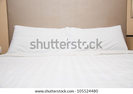 pillow and blanket on bed in hotel - stock photo