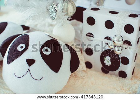 pillow-dog and a gift under the tree - stock photo