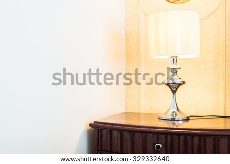 Pillow on bed with light lamp decoration interior of bedroom