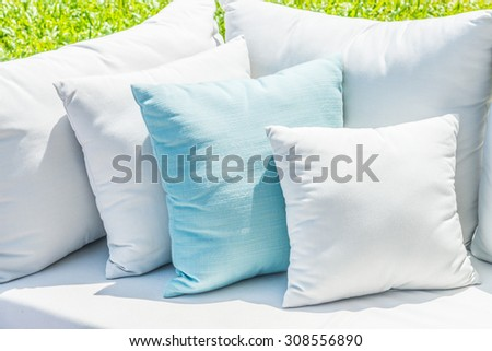Pillow on sofa bed with outdoor view - stock photo