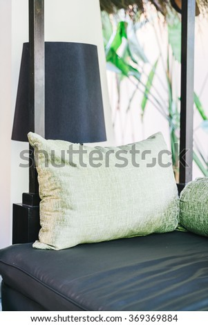 Pillow on sofa decoration in living room interior - Filter effect