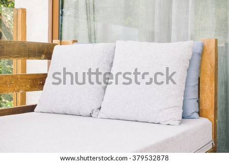 Pillow on sofa decoration in livingroom interior - Light Vintage Filter