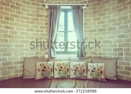 Pillow on sofa decoration in livingroom interior - Vintage Filter - stock photo