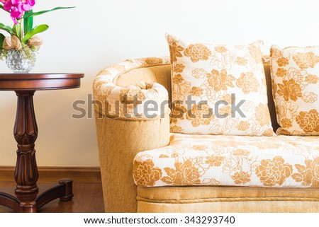 Pillow on sofa with light lamp decoration of living room interior