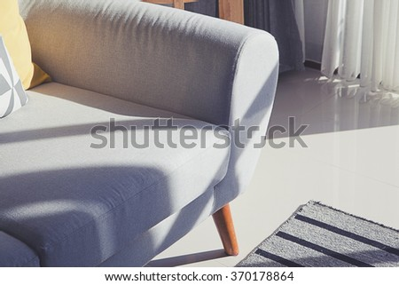pillow on sofa with sunlight