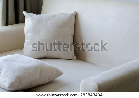 pillow placed on Sofa cream color