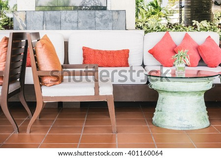 Pillow sofa and chair decoration in livingroom interior - Vintage Light Filter