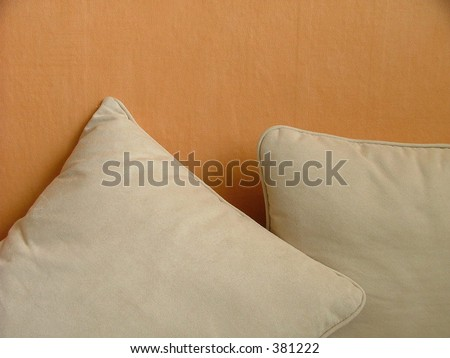 pillows and orange wall