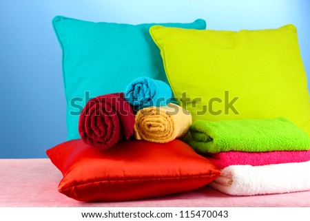 pillows and towels on blue background