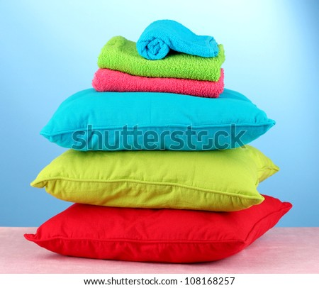 pillows and towels on red background