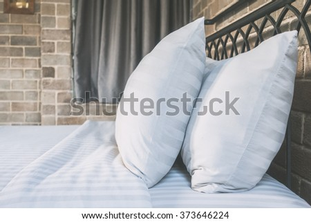 Pillows on bed decoration in bedroom interior - Vintage filter