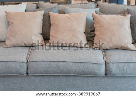 pillows on grey sofa in modern living room design