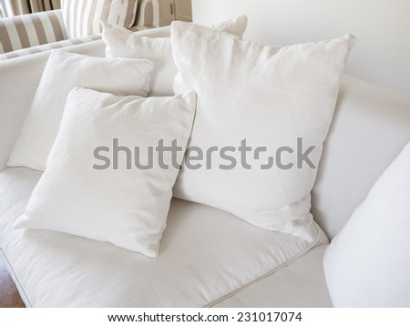 Pillows on sofa room interior decoration background - stock photo