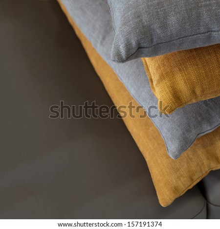 pillows on the leather - stock photo