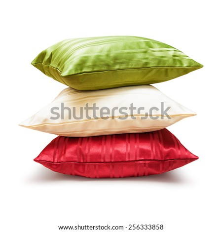 Pillows stack isolated on white background. Object with clipping path - stock photo