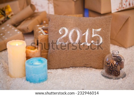 pillows with 2015 and candles on the floor - stock photo