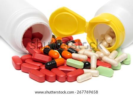 pills an pill bottle on white background . - stock photo