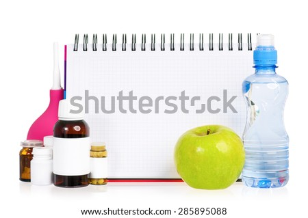 Pills and blank notepad for text, isolated on white background - stock photo