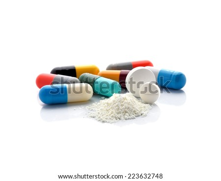 pills and capsules isolated on white background - stock photo
