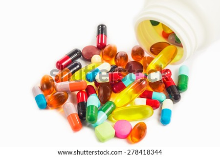 pills and capsules on white background - stock photo