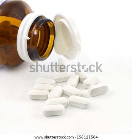 pills and container - stock photo