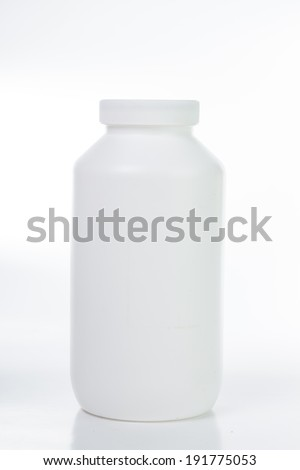 Pills and drug container isolated with white background