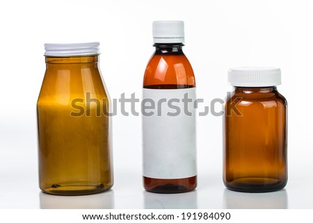 Pills and drug container isolated with white background - stock photo