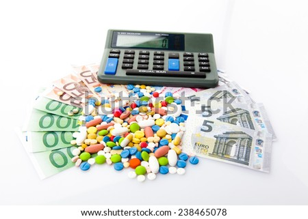 pills and euro banknotes. medical concept - stock photo