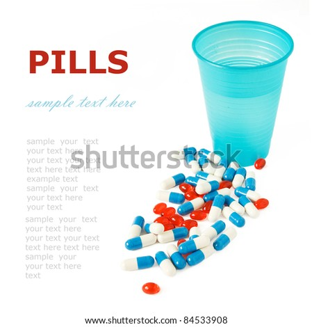 Pills and glass of water isolated on white with sample text