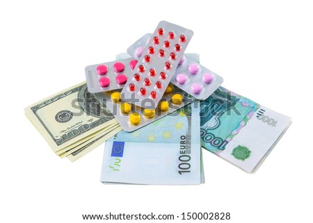 Pills and money are photographed on the white