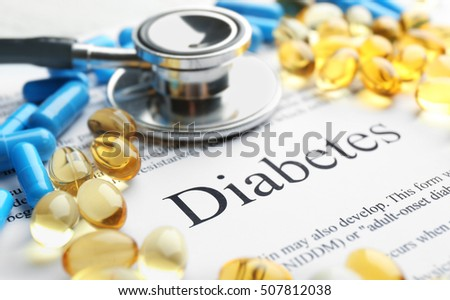 Pills and stethoscope on paper with text. Diabetes concept
