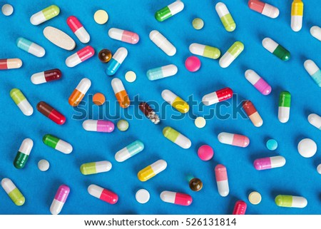 pills and tablets of different colors background. little depth of field