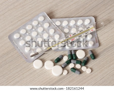 Pills and tablets, on a light table