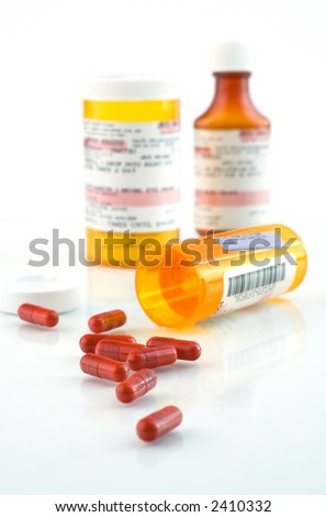 Pills and vials on white background - stock photo
