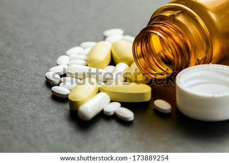 Pills and Vitamins, Concept of Health and Medicine-  Studio Shot with Macro Lens using shallow depth of field - stock photo