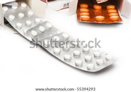 pills at the packages over white