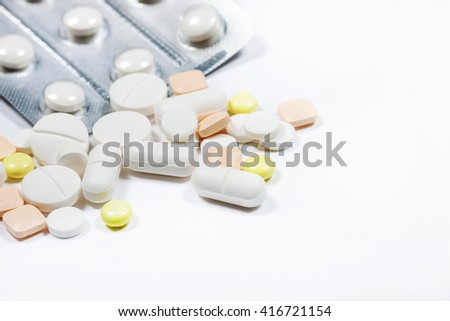 Pills close up on a light background. Medications. A variety of medications. - stock photo
