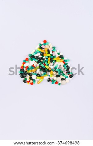 pills grouped in form of heart