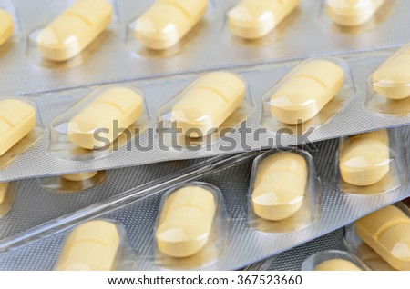 Pills in aluminium blister package, close up, DOF - stock photo