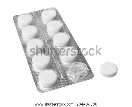 Pills in blister pack on a white background