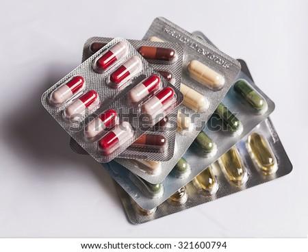 Pills in blister pack  pill vitamin pills vitamins capsule blister packaging pill vitamin pills vitamins capsule blister packaging pill vitamin pills vitamins capsule blister packaging pill vitamin - stock photo