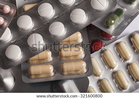 Pills in blister pack  pills pill capsule vitamin blister  medicine antibiotic pills pill capsule vitamin blister  medicine antibiotic pills pill capsule vitamin blister  medicine antibiotic pill pill - stock photo