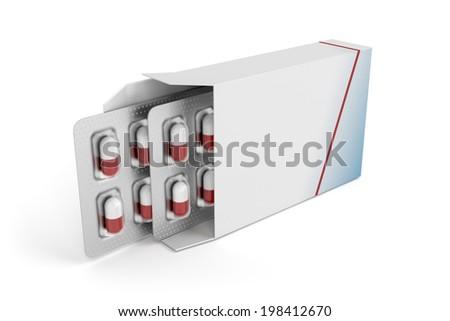 Pills in blister packs in box - stock photo