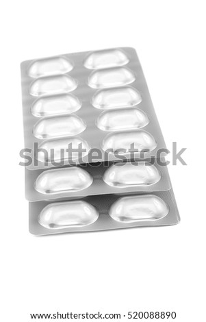 Pills in blister packs isolated on white background.