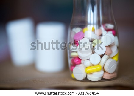 Pills in bottle close-up.