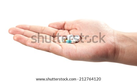 pills in hand - stock photo